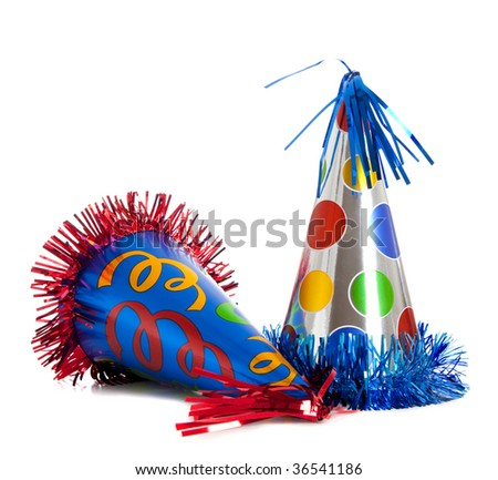 Group of colorful birthday party hats on white background with copy space