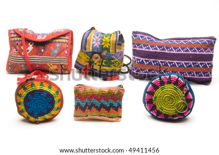 group of colorful handbags purses coin change holders and satchels made in honduras panama guatemala nicaragua in central america
