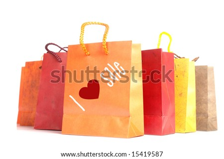 Group of colorful paper shopping bags over white background