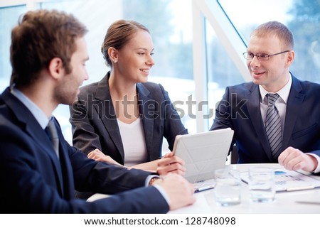 Group of confident business partners planning work at meeting - Shutterstock ID 128748098