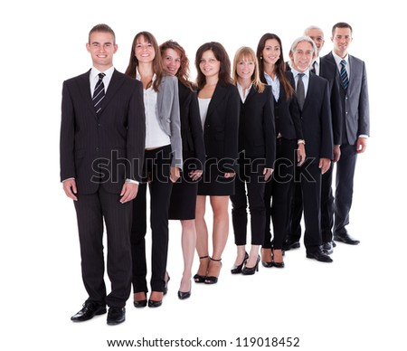 Group of confident business people in a team or partnership standing in a staggered row smiling at the camera isolated on white - stock photo