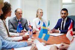 Group of confident politicians taking part in international event of political representatives