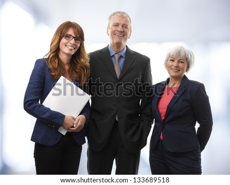 Group of confident professional managers standing in the office