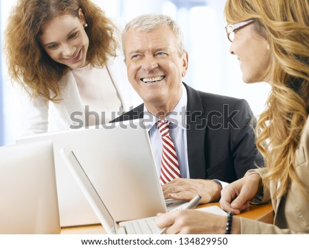 Group of confident professional managers working in the office. Shallow focus.