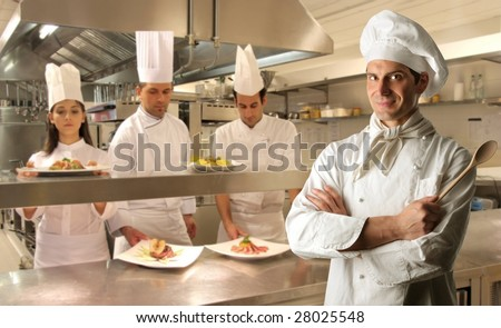 group of cooks in a kitchen