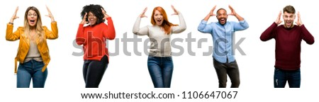 Group of cool people, woman and man happy and surprised cheering expressing wow gesture #1106647067