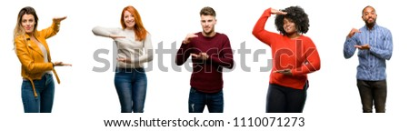 Group of cool people, woman and man holding something, size concept #1110071273