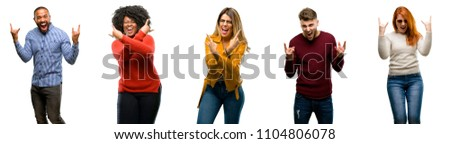 Group of cool people, woman and man making rock symbol with hands, shouting and celebrating #1104806078