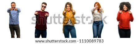 Group of cool people, woman and man pointing to the front with finger #1110089783