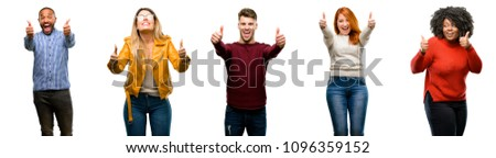 Group of cool people, woman and man stand happy and positive with thumbs up approving with a big smile expressing okay gesture
