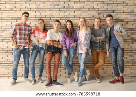 Group of cool teenagers indoors
