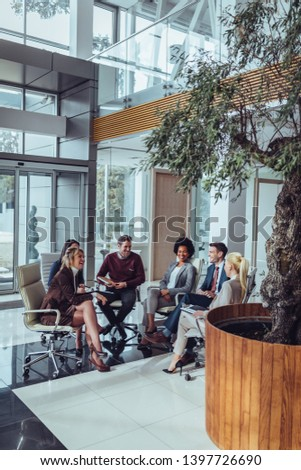 Group of coworkers having meeting and discussing about business goals #1397726690