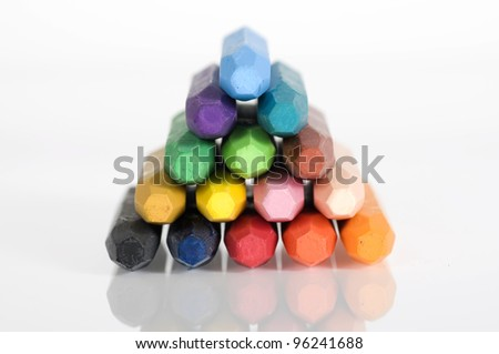 Group of crayons stacked on white background