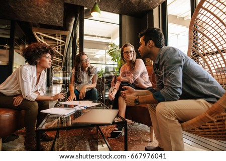 Group of creative people having a meeting in a modern office. Business people having conversation over new project. #667976041