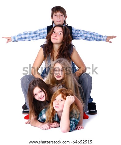 Group of cute, attractive and happy kids posing on white background