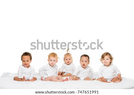 group of cute multiethnic toddlerboys and girls isolated on white
