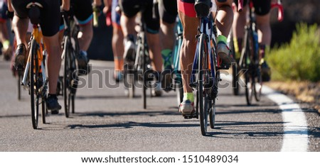 Group of cyclist at professional race, cyclists in a road race stage #1510489034