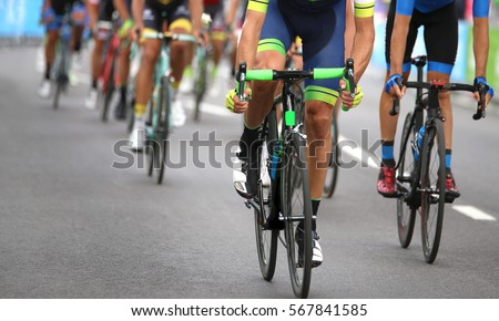 group of cyclists during the final sprint to win the stage of the cycling race #567841585