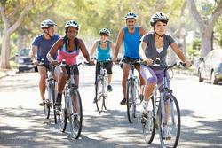 Group Of Cyclists On Suburban Street