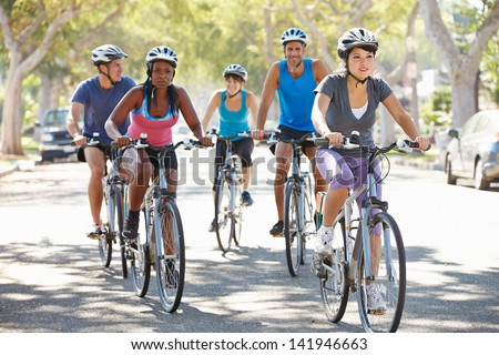 Group Of Cyclists On Suburban Street - stock photo