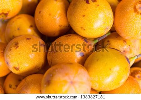 Group of delicious fresh and ripe granadillas passion fruit in the market. Colorful granadillas passion fruit of intense orange color. #1363627181