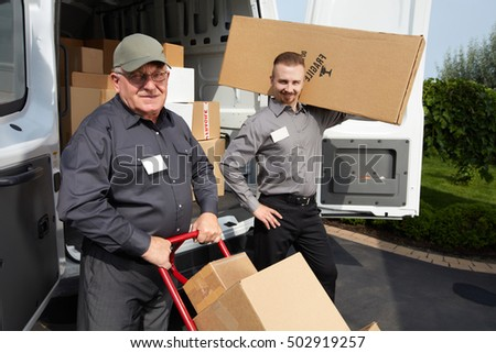 Group of delivery man with a parcel. #502919257