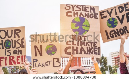 Group of demonstrators on road, young people from different culture and race fight for climate change - Global warming and enviroment concept - Focus on banners #1388894738
