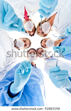 Group of dentists holding medical instruments at the hospital