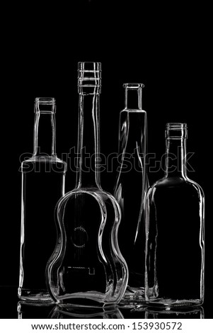Group of different bottles with nice design on black.