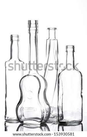 Group of different bottles with nice design on white.