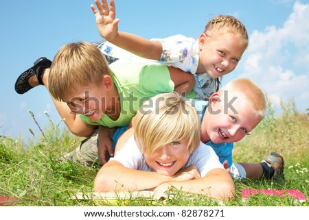 Group of different children having good summertime