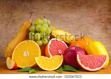 group of different fruits on a wooden background