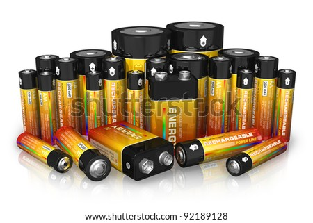 Group of different size batteries isolated on white reflective background