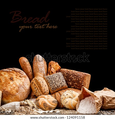 Group of different types of bread on black background