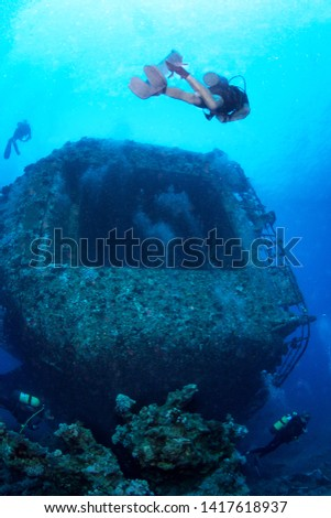 Group of divers explore the wreck, Red Sea, Egypt. #1417618937