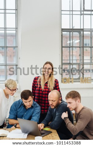 free photos young casual business people sitting around conference