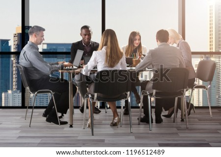 Group Of Diverse Businesspeople Sitting In Office During Business Meeting #1196512489