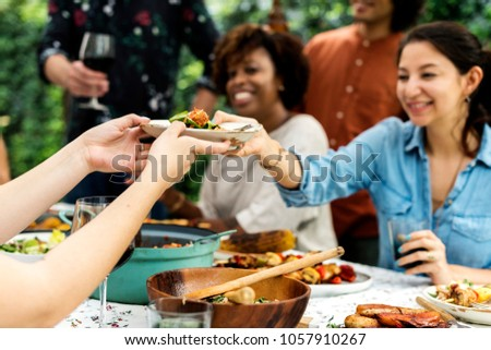 Group of diverse friends enjoying summer party together #1057910267