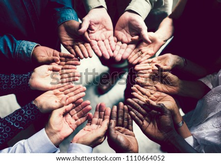Group of diverse hands in a circle