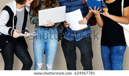 Group of Diverse High School Students Using Digital Devices Studio Portrait #624967781