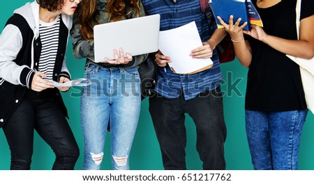 Group of Diverse High School Students Using Digital Devices Studio Portrait #651217762
