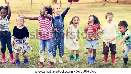 Group of Diverse Kids Playing at the Field Together #663004768