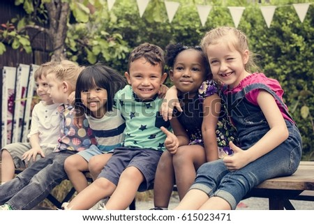 Group of Diverse Kids Sitting Together #615023471