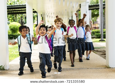 Group of diverse kindergarten students running cheerful after school