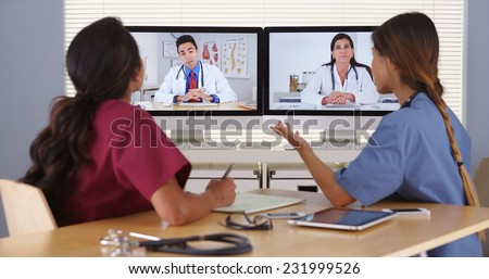 Group of diverse medical doctors video conferencing