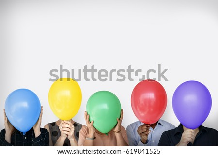 Group of Diverse People Faces Covered with Balloons #619841525