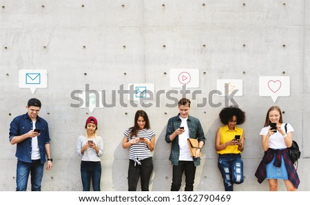 Group of diverse people using their phones