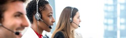 Group of diverse telemarketing customer service staff team in call center banner background
