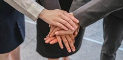 Group of diversity people hand stacked. Imply to their trusted in business teamwork and collaboration together.