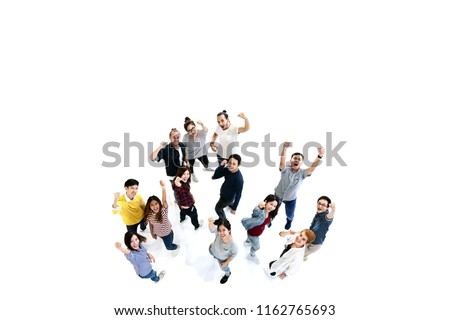 Group of Diversity People Team looking at camera with isolated white floor background. Creative teamwork feeling happy, enjoy and engage with achievement project with overhead aerial view concept. #1162765693